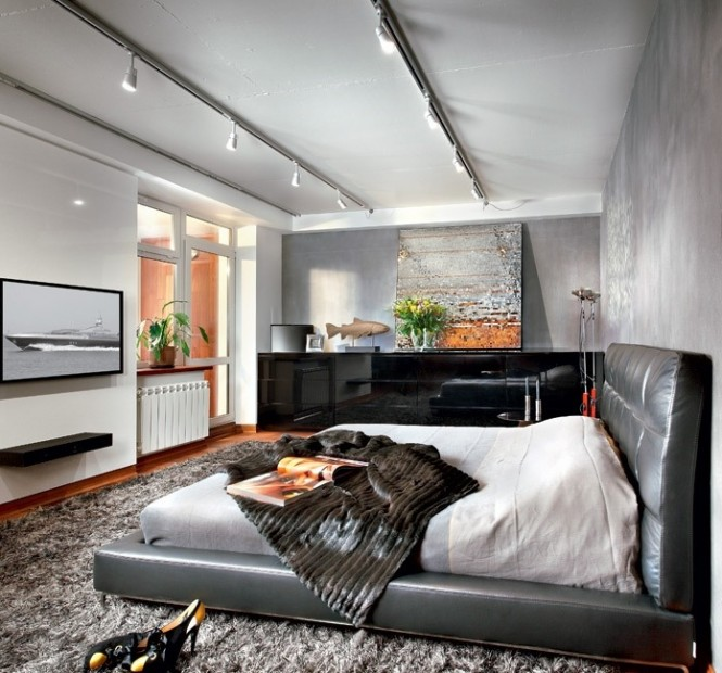 This soft black leather bed is a wonderful statement piece, but you don't have to break the bank to get a similar look; there is a whole host of convincing leatherette beds on the market at a fraction of the price of their cow hide cousins. The low-level platform style of this piece is complimented by a long sleek sideboard and floating shelf in the same color.
