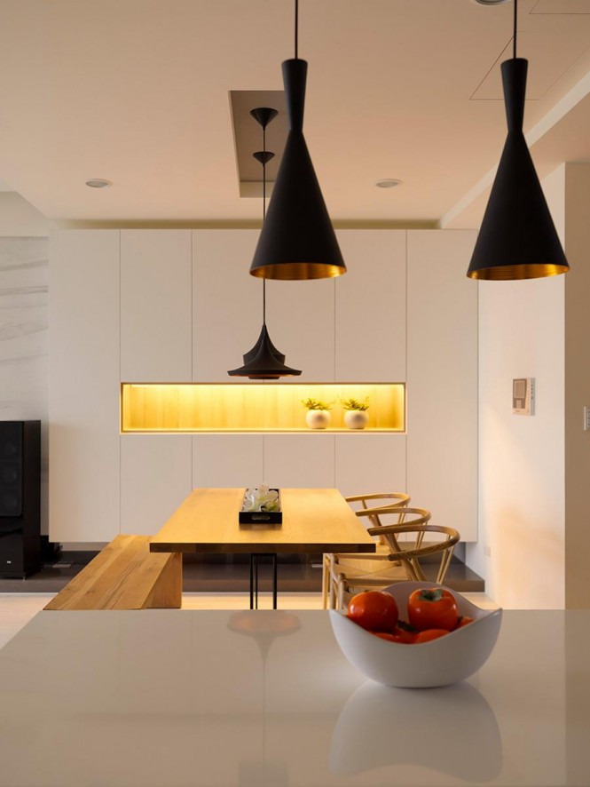 Zone pit stops can be created with the introduction of carefully placed pendant lights in strong colors; this interior uses bold black shades in varying shapes to draw the eye and define each area.