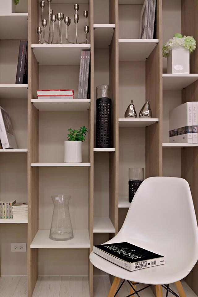 A home office situated behind the lounge is backed by a huge wall of attractive shelving that is divided into irregular cubby holes, where attractive items can be displayed over undulating levels.