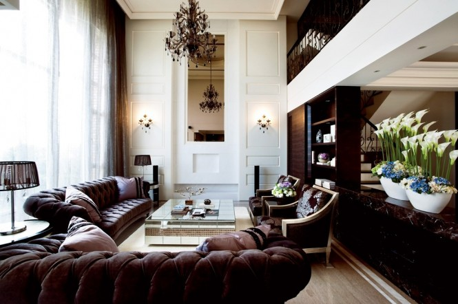 Via Designer Raymond ChenChandeliers for high ceilings always look amazing when picked in generous proportions as their complex designs demand attention, and their sparkle looks expensive. Alternatively, you can install track lighting that isn't meant to be a focal point, but is easily moveable over long areas for useful task lighting as and when needed, even if you should have a quick furniture change around.