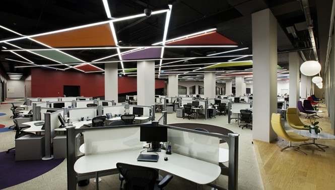 With incredibly high ceilings in the main open plan working area acoustical problems were overcome with sound absorbing panels and an irregular order of lighting instruments.
