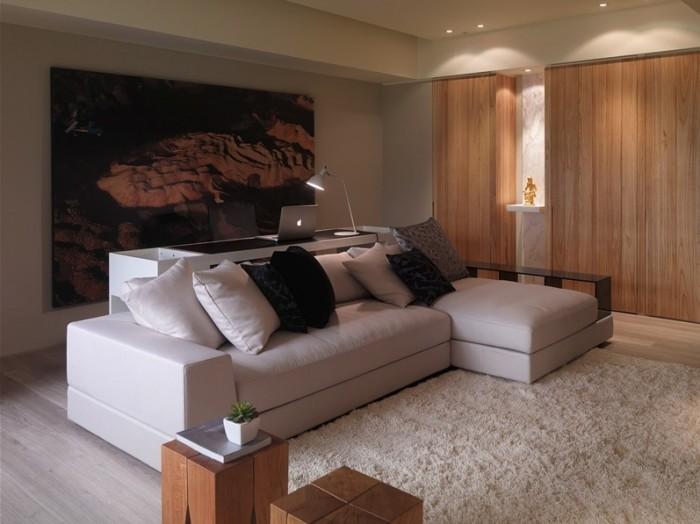 A large piece of wall art is allowed to speak volumes in this serene setting.