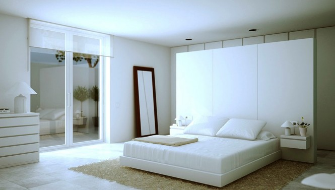 An oversized headboard acts as a dividing wall between the sleeping and dressing areas.