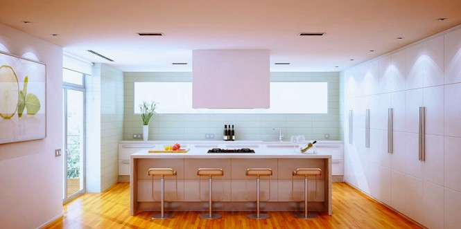 Banks of floor to ceiling kitchen cupboards are large enough to store overflow from the entire household.