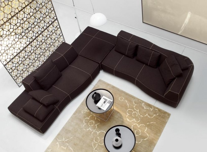 Sofas work well when arranged in an L shape arrangement, which creates a cozy corner to cuddle up in at the end of the day.