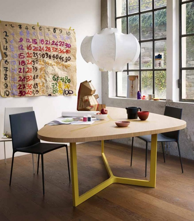 This contemporary table, complete with acid yellow legs gives an edgy look to the corner of the room with its irregular shape.