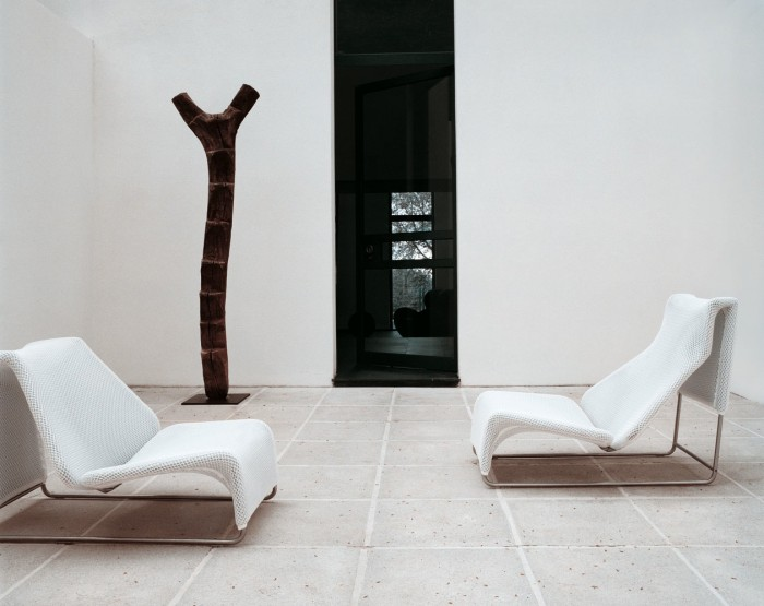 Modern white lounger chairs