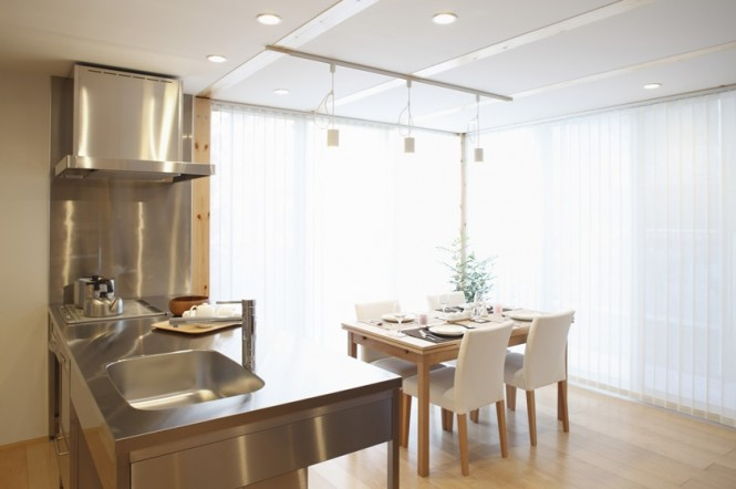 In the dining area, natural light pours in through generous dual aspect windows.