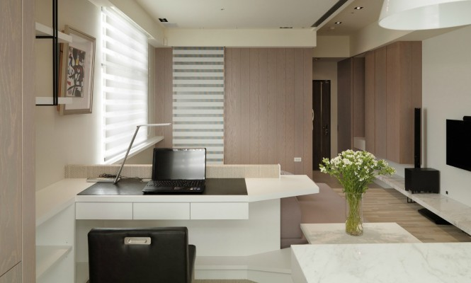 Despite the limited proportions of this dwelling, a dedicated home office space has been achieved, complete with a bespoke desk and a generous amount of storage cubbies.