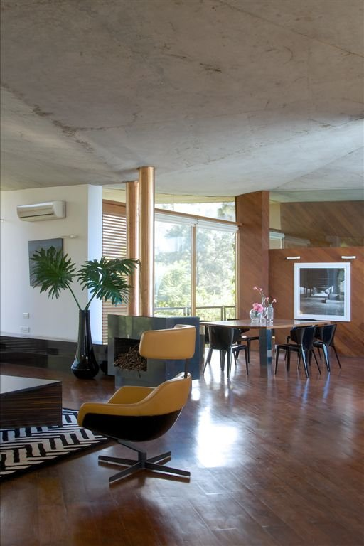 Exposed concrete can be found throughout the house along with teak timber floors and accent walls.