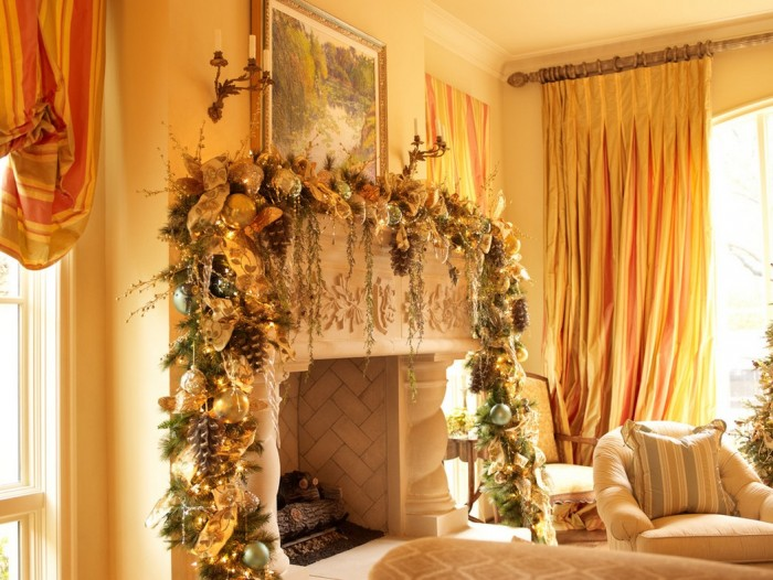 This gorgeously stunning mantel décor pulls colors from the room into the heavily laden garland full of pine cones, ribbons, mirrored balls, trailing vines and golden leaves.