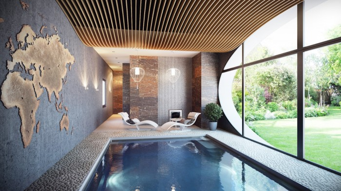 The ceiling application in the home&#039;s indoor spa arches over the pool and is mimicked by the oval window overlooking the gardens. The map is cut from a sheet of brass.