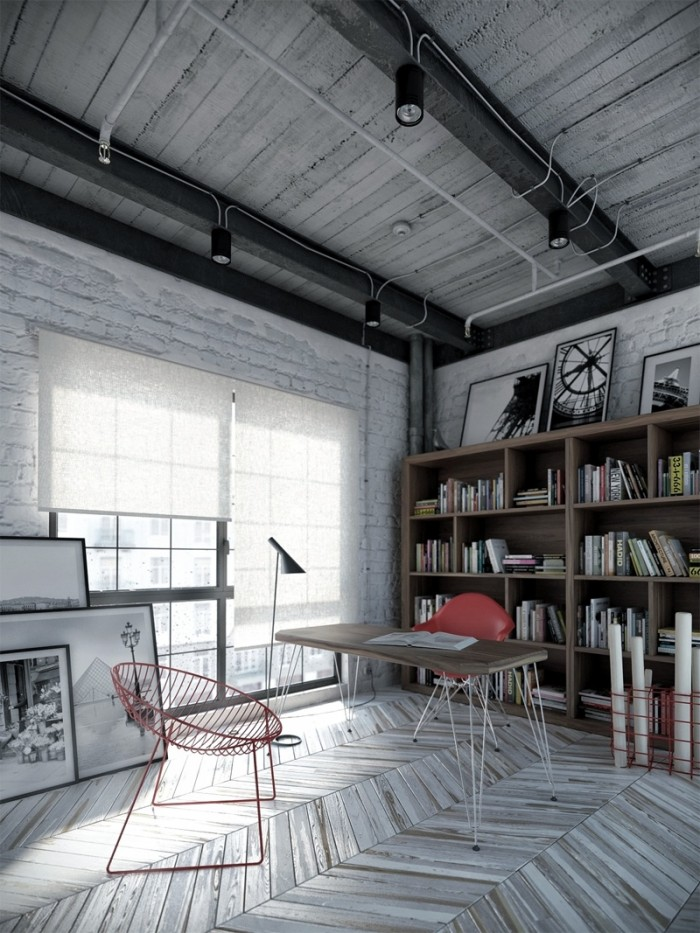 An eclectic converted industrial workspace comes alive with chevron wood floors in weathered gray variations and pops of red on the chairs and accents.