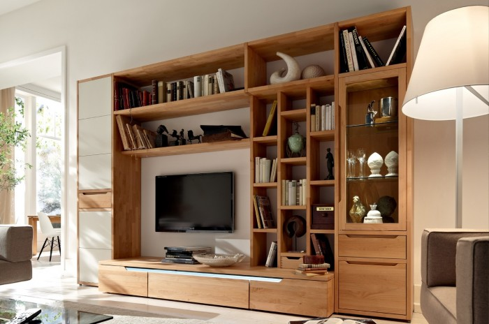 This entertainment center spans floor to ceiling, offering a myriad of shelving possibilities and storage space.