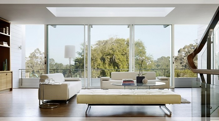 Architect John Maniscalo created this contemporary house around the ultimate use of natural light. With its retracting wall of windows and large open skylight, this living area looks as if it is floating in the trees.