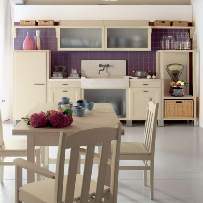 This kitchen has a modern styling to it, unlike any of the other pieces in the collection. It is carried even farther in that direction by the purple tile backsplash and wall.