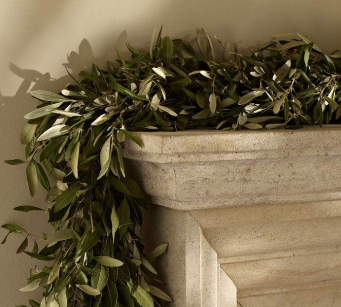 Let nature speak for itself like this single garland of greenery placed on the mantel.
