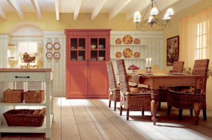 A pumpkin-hued china amoire adds a punch of color to this gorgeous old world style eat-in kitchen. It is certainly warm and cozy and feels like fall.