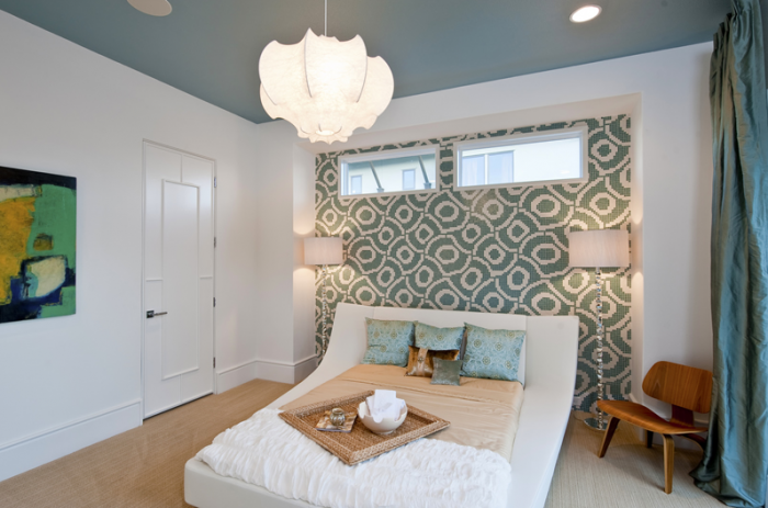 The basement is a perfect spot to tuck away a bedroom for extra privacy for guests and homeowners alike.