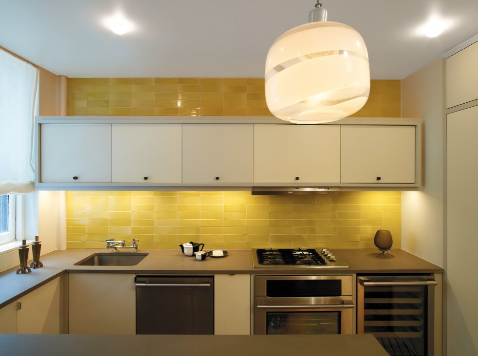 brilliant yellow tile backsplash