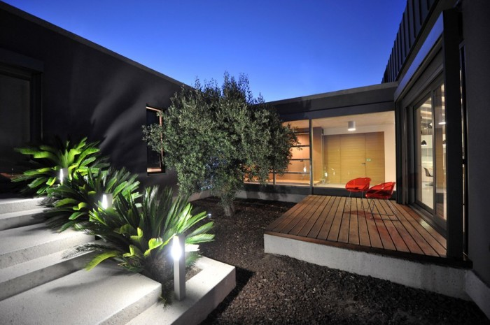 The home was built in a U-shape to enclose a central courtyard accessible from each of the three wings.