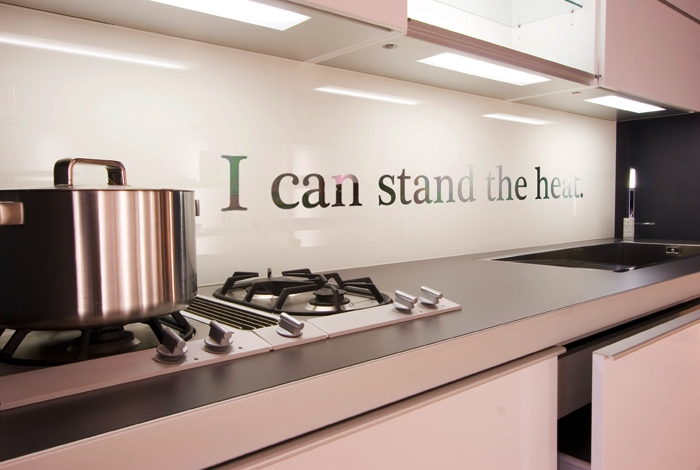Wall quotes provide an inspiring way to decorate your backsplash.