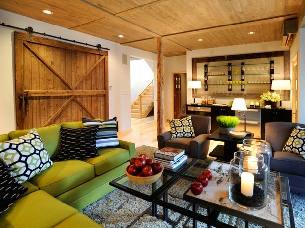 Fresh cilantro and inky black make an impact against rustic wood elements in this attractive basement living space remodel.