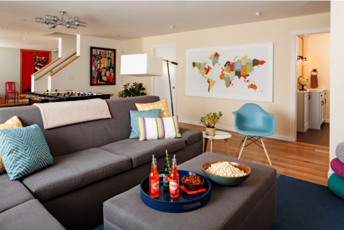 Vibrant pops of color bring this basement living space to life.