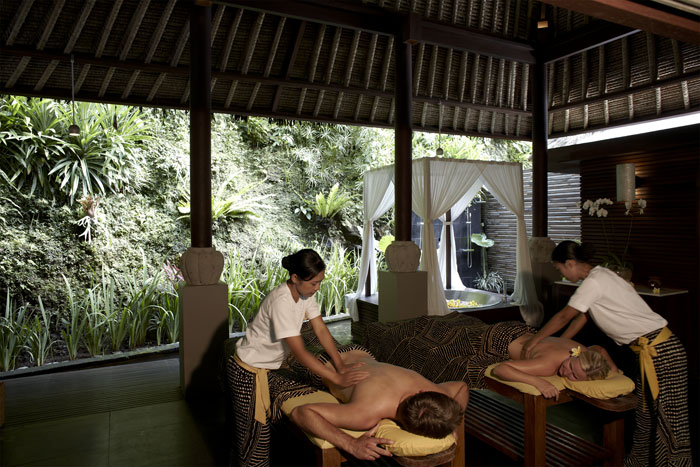 The resort's spa areas are open to the river and jungle below with an outdoor massage and relaxation area.