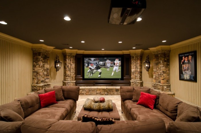 This basement media room/family room combination provides the perfect spot to gather with family and friends. The decor is natural and pleasing to the eye.