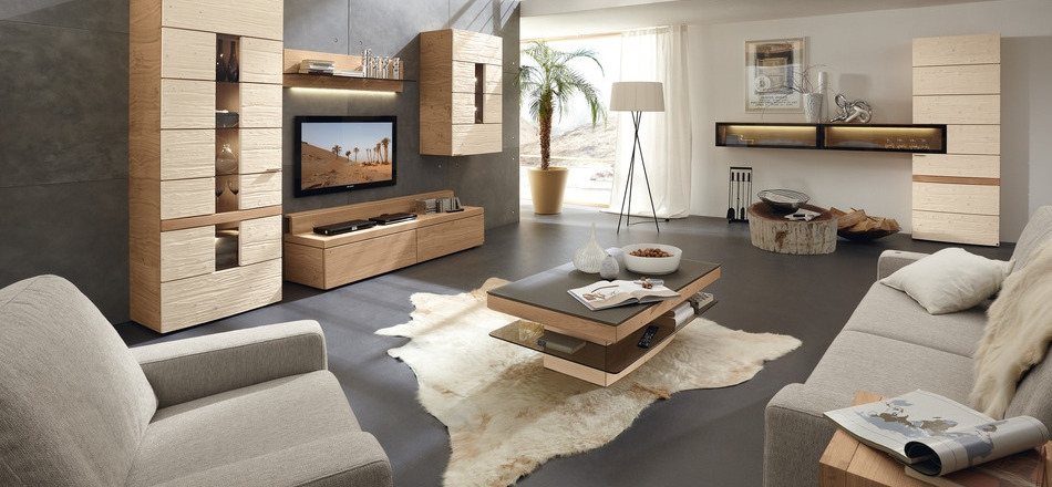 This rustic modern living room extends a welcoming appeal with earthy