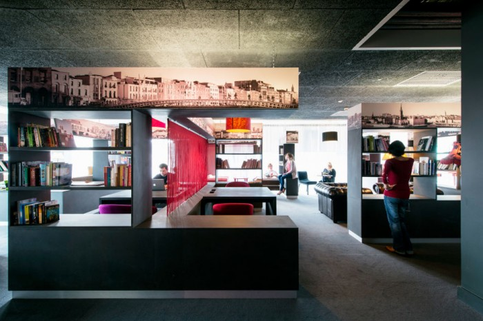 While much of the Google Docks offices are decorated in brilliant hues, this is workspace is a bit more subdued with black and white elements with touches of red.