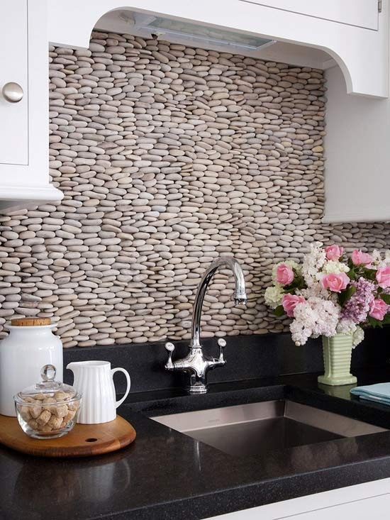 Cobblestones set on applied on their sides makes a unique backsplash full of interest and texture.