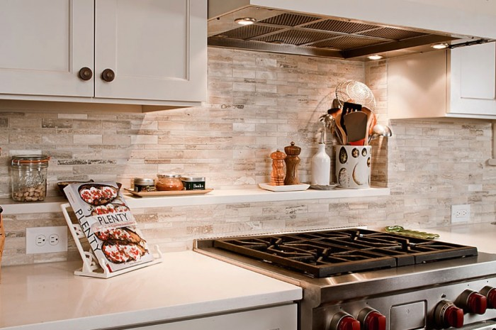 A backsplash shelf gives adds extra space for holding spices, jars and utensils.