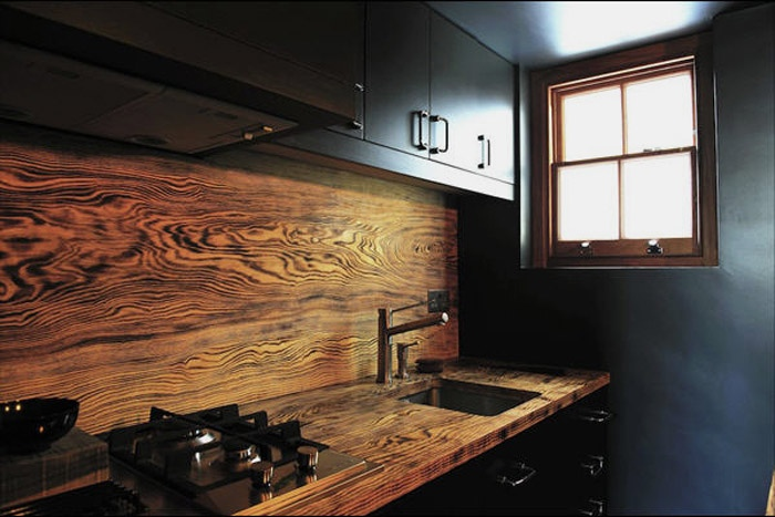 Fine woods such as this zebra wood backsplash add so much character to the kitchen.