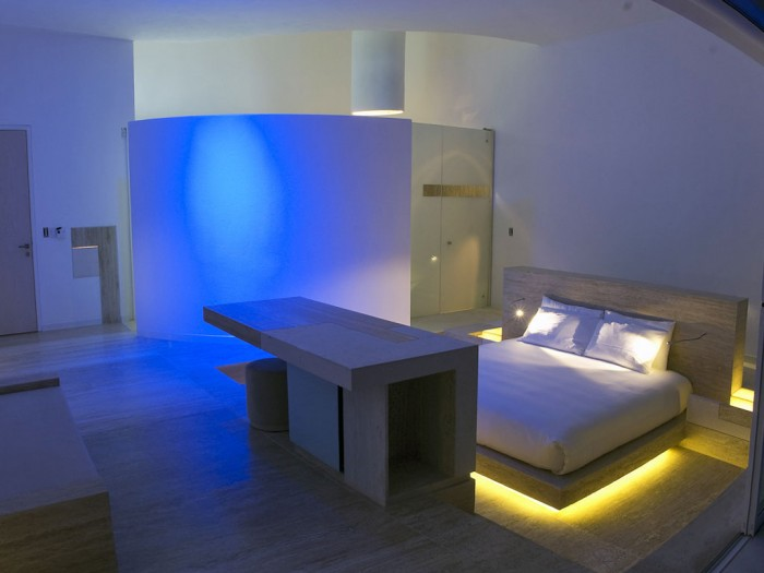 The guest rooms also are aglow in vibrantly hued ambient light as seen here.