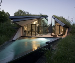 house built into hill moonlit pool front