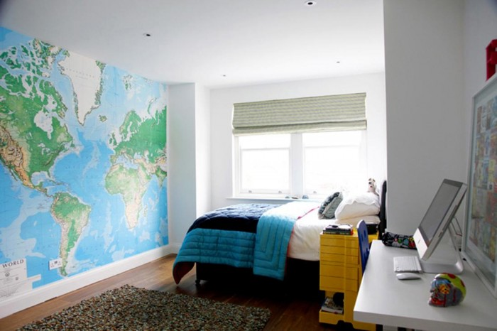 One of four bedrooms, this boy's room features a map that expands one whole wall. The colors of the map are pulled through from the wall to the bed. Modern Victorian House in London Modern Victorian House in London modern victorian home bedroom boys 700x466