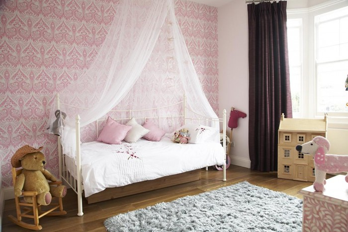 The little girl's room holds true to the home's Victorian heritage with an iron day bed and vintage decor.