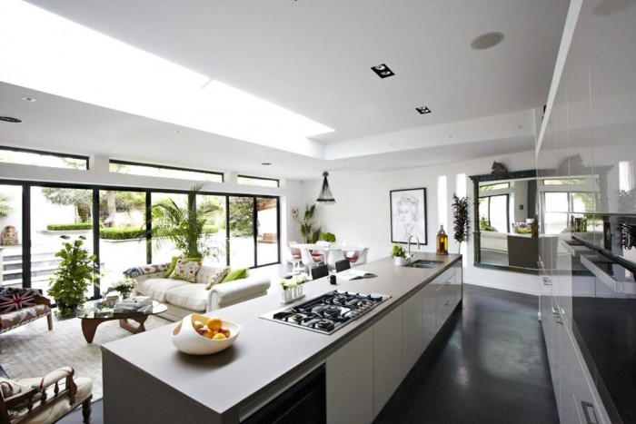 The kitchen is sleek and up-to-date and is unobtrusive in the midst of the living space.