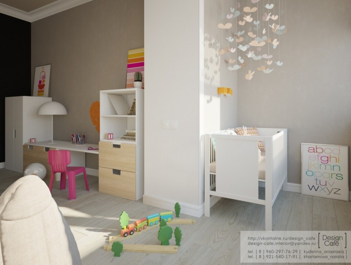 The children's room features a small nursery area, bed for older child and play area.