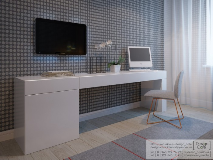 A full-size office area is situated opposite the bed in the master bedroom.
