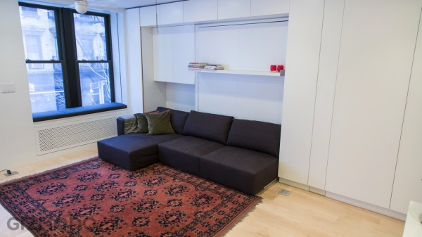 The tiny apartment house includes a full size living room with many hidden unexpected transforming possibilities.
