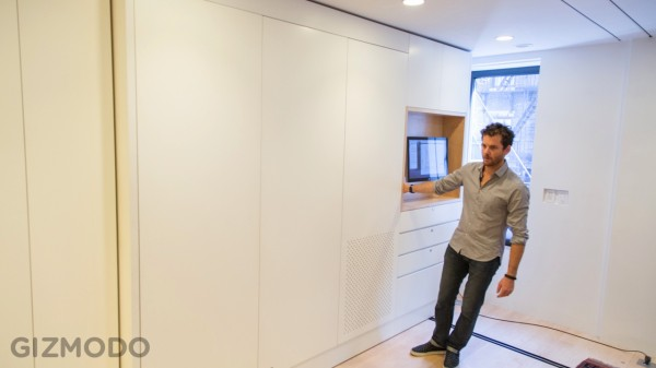 An office wall pulls out from a modular wall unit into an instant full size work space.