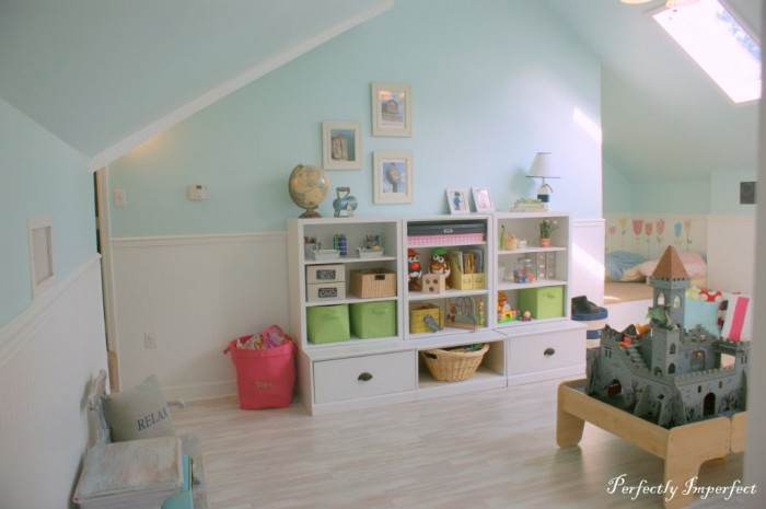 A perfectplay room.com soft attic style child's room pastels and white with storage