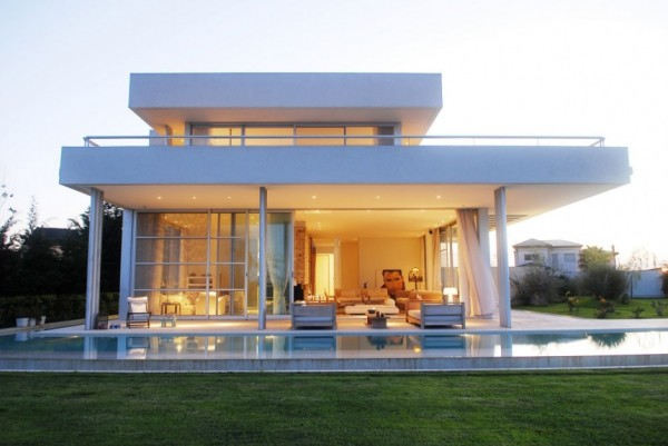 Exterior Modern White Agua House at dusk