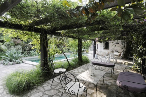 Pergola pool view with cast iron furniture