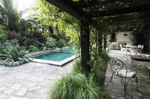 Pergola pool view with shrubbery