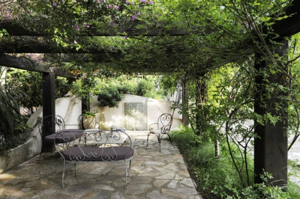 Pergola with cast iron outdoor furniture