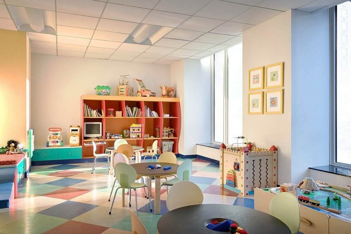 Pretty pastel child's playroom large open-plan